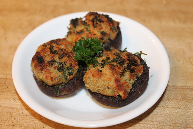 cooked shrooms with clam stuffing